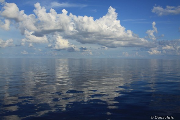 Clouds reflecting on calm the calm sea - Gulh of Mexico