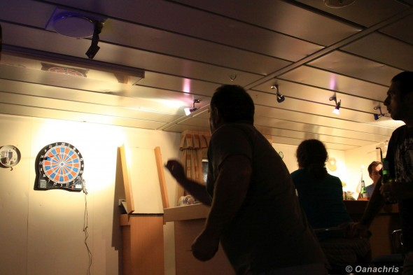 Playing darts on board HS Bach