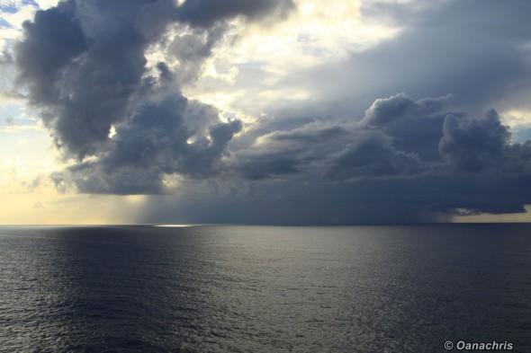 Rain and sunset in Atlantic Ocean