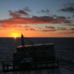 Sunset and rolling in South Atlantic Ocean
