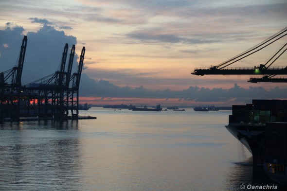 Sunset over the port of Singapore