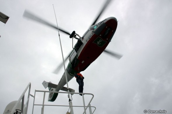 Pilot coming on the vessel by helicopter (1)